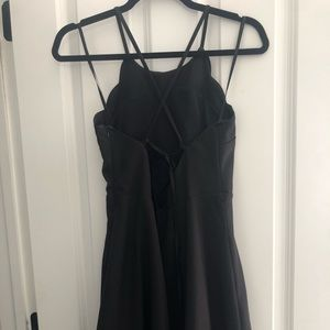 Little black dress with scalloped edges